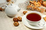 Photo of a tea mug and teapot with black tea