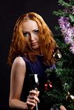Young beauty red woman and christmas tree