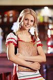 A young waitress in a German national costume