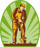 Gardener or farmer digging with shovel