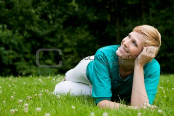 laying down on the grass