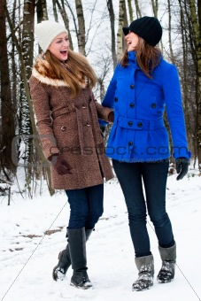 sister laughing on a winter white road