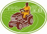 male gardener riding lawn mower