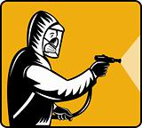 Pest control exterminator spraying pesticide
