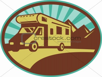 Camper van travel with mountains and sunburst