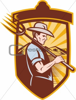 Farmer with pitch fork and mountains in back