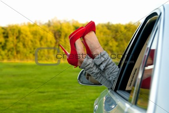 Red pumps out of the car