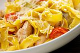 Spaghetti pasta with cheese, chicken and tomato
