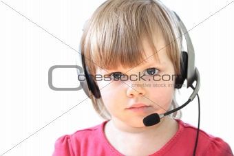 Toddler girl with a headset