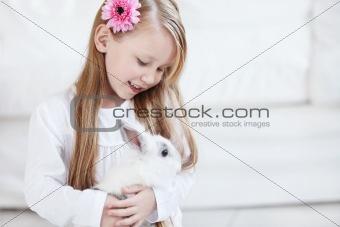 Little girl and white rabbit