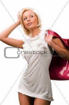 beautiful young woman with a pink handbag