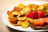 Beef steak with sliced potatoes