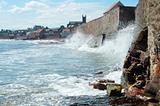 waves crashing against sea wall