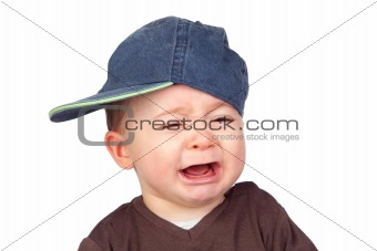Beautiful baby crying with a cap