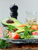salad with tomato and avocado on a crystal  plate