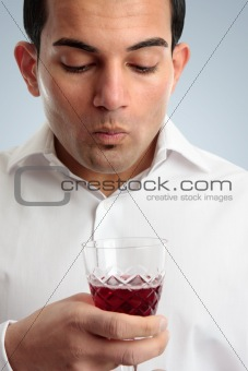 Man tasting red wine