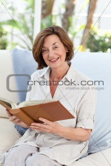 Old woman reading her book