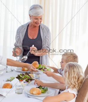 Grandmother serving her grandchildren