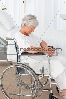 Senior woman in her wheelchair