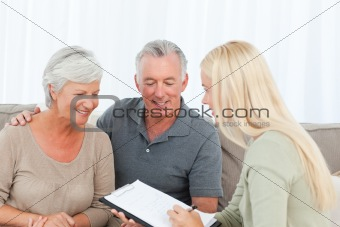 Seniors with doctor at home