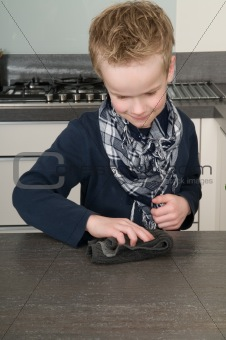 Boy cleaning the kitchen