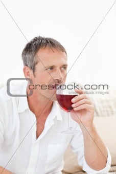 Handsome man drinking some red wine