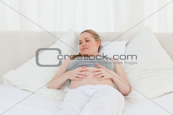 Beautiful woman with her hands on her belly