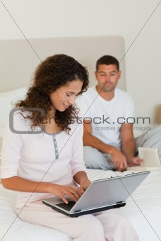 Woman working on her laptop wh