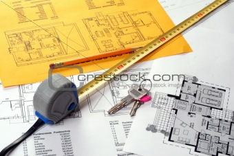 Tools on Blueprints including measuring tape, keys and pencil