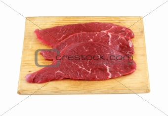 Three raw steaks