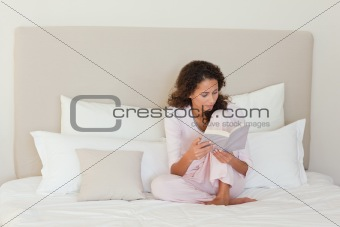 Beautiful woman reading a book at home