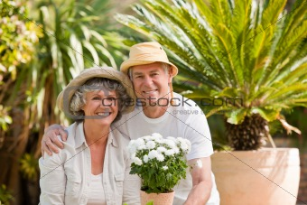 Senior couple looking at the camera in the garden