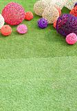 color rattan ball on green grass.