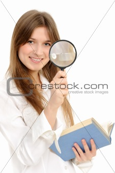 Businesswoman using magnifying glass