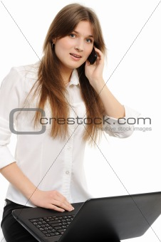 business woman with laptop speaks via phone