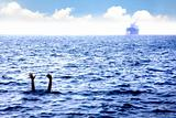 man drowning in the sea and waving hand for help