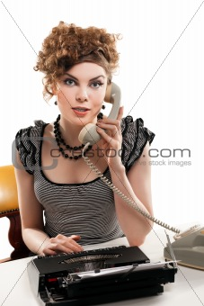 Businesswoman taking telephone call in office