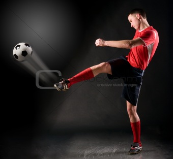 soccer player strikes