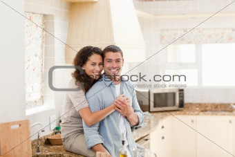 Beautiful couple hugging in the kitchen