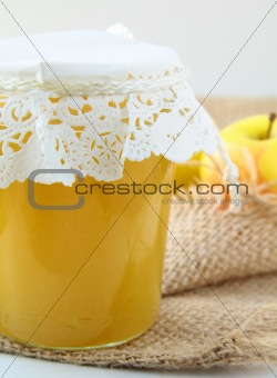 apple jam in a glass jar on the table