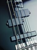 details of electric bass, pickups and cords