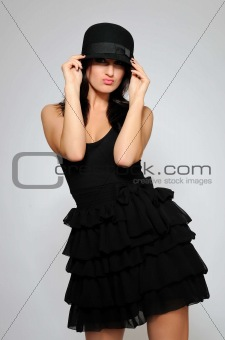 Beautiful fashion model in black dress with evening make-up