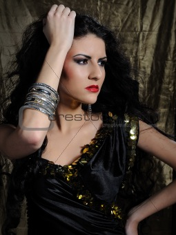 Beautiful model woman with long black healthy hair
