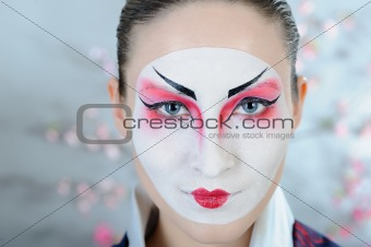 japan geisha woman with creative make-up.close-up