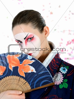 japan geisha woman with creative make-up with fan