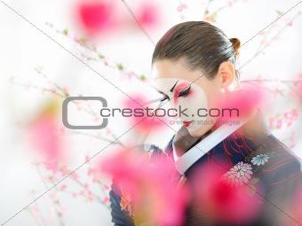 Artistic portrait of japan geisha woman with creative make-up