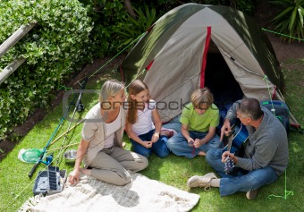 Happy family camping in the g