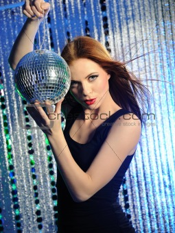 Attractive sexy woman dancing in the disco