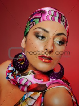 Beautiful woman with fashion make-up. red background