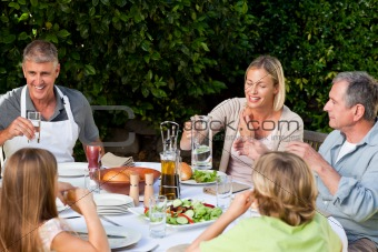 Lovely family eating in the garden